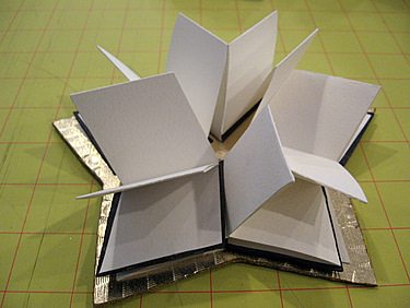A piece by Jill Abilock - interior of a book using Iris folding for the covers